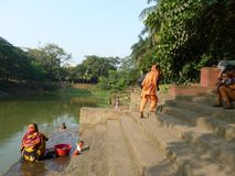 Women clean clouthes water at dhaka city park. Stock Photography
