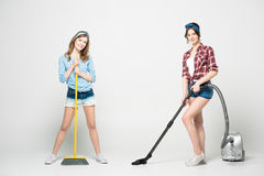 Women with cleaning appliances stock photography