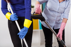 Women during cleaning floor Royalty Free Stock Photo