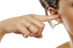 Women cleaning her ear. With her finger Stock Photos