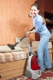 Women cleaning her living room. Royalty Free Stock Photos