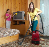 Women cleaning  in living room Royalty Free Stock Photography