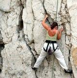 Women climber 1. Women climbing cliff stock photos