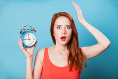 Women with clock Royalty Free Stock Photography