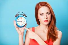Women with clock Stock Photos