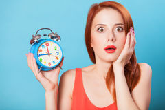Women with clock Royalty Free Stock Image
