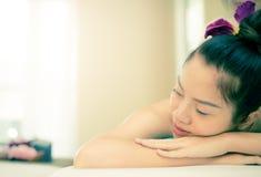 Women closed eye is relaxing in Spa. Women with closed eye is relaxing in Spa stock images