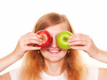 Women closing with eyes two apples. Isolated on white background Royalty Free Stock Photos