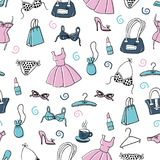 Women clothes and accessories, hand drawn doodle seamless pattern. Vector seamless pattern with cute hand-drawn women`s accessories - clothing, lingerie Stock Images