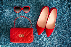 Women clothes and accessories. Red Shoes and leather handbag. Fa Stock Photo