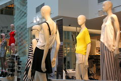 Women clothes. Dressed mannequins in shop - seasonal clothes for women Royalty Free Stock Photography