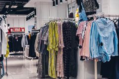 Women clothes hanging in the fashion store. Shopping mall. royalty free stock photos