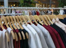 Women clothes hanging on wooden hangers royalty free stock images