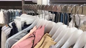 Women clothes in the store. Female fashion clothes in the shopping mall. 4K clothing footage. Women clothes in the store. Female fashion clothes in the shopping stock footage