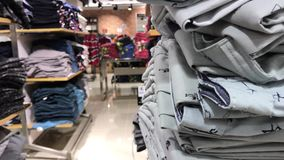 Women clothes in the store. Female fashion clothes in the shopping mall. 4K clothing footage. Women clothes in the store. Female fashion clothes in the shopping stock video footage