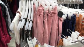 Women clothes in the store. Female fashion clothes in the shopping mall. 4K clothing footage. Women clothes in the store. Female fashion clothes in the shopping stock video