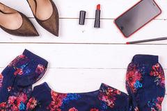 Women clothing set and accessories on a rustic wooden background Royalty Free Stock Photography