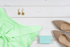 Women clothing set and accessories on a rustic wooden background.Top view Stock Image