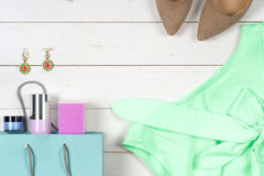 Women clothing set of cool stuff and accessories on light background. Top view. Stock Image