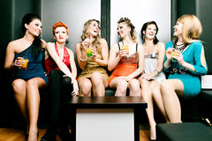 Women in club or disco drinking cocktails Stock Image