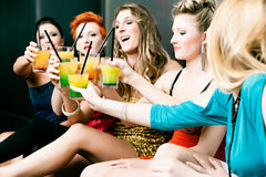 Women in club or disco drinking cocktails Royalty Free Stock Photos