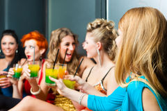 Women in club or disco drinking cocktails Royalty Free Stock Images