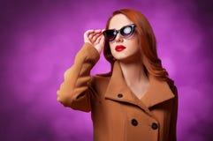 Women in coat Stock Images