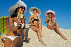 Women with cocktail on beach Royalty Free Stock Photography