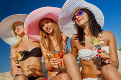 Women with cocktail on beach Royalty Free Stock Photo