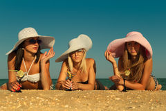 Women with cocktail relaxing on beach Stock Image