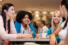 Women on coffee break. Four young women having coffee break royalty free stock photos