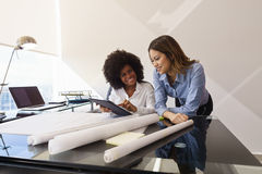 Women Colleagues Architect With Tablet PC And Blueprints Stock Photo