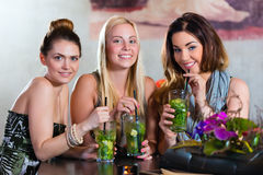 Women or colleagues in cafe, bar or restaurant. Young women in cafe, bar or restaurant, drinking cocktails and enjoying the leisure time stock images