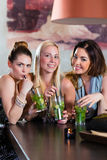 Women or colleagues in cafe, bar or restaurant. Young women in cafe, bar or restaurant, drinking cocktails and enjoying the leisure time royalty free stock photography
