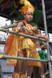 A women in colorful dress at Notting Hill carnival Stock Photography