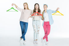 Women with colorful hangers Royalty Free Stock Images