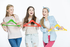 Women with colorful hangers Stock Photography