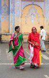 Women with colorful sarees on street in Jaipur, India. Detail of old building with donkeys in Jaipur, India.Women with colorful sarees on street in Jaipur, India stock image