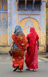 Women with colorful sarees on street in Jaipur, India. Detail of old building with donkeys in Jaipur, India.Women with colorful sarees on street in Jaipur, India royalty free stock images