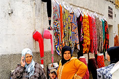 Women and colors in the medina of Essaouira. Essaouira Morocco Two women with Arab children walk in colorful clothes. Essaouira in Arabic: الصويرة, al-Ṣ Royalty Free Stock Image