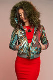 Women in colourful jacket with triangle, black necklace royalty free stock photography