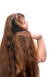 Women combing her beautiful long red hair Royalty Free Stock Images