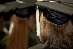 Women at a Commencement Ceremony. Female students at a graduation ceremony listening to the commencement speaker Stock Photos