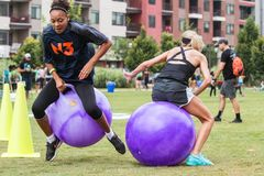 Women Compete In Bouncy Ball Race At Atlanta Field Day stock photography
