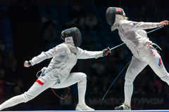 Women compete on championship of world in fencing Royalty Free Stock Images