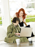 Women by the computer Royalty Free Stock Photo
