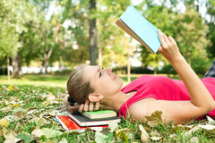 Women concentrate on reading. Woman in park concentrate on reading book Royalty Free Stock Photo