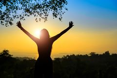 Women confident determination to target achievement. Silhouette women raise hands up as new day beginning early morning fresh air outdoor royalty free stock photography