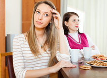 Women after conflict at table. Two women after conflict at table Stock Photos