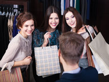 Women consult with shop assistant. Girls consult with shop assistant concerning buying presents Royalty Free Stock Images